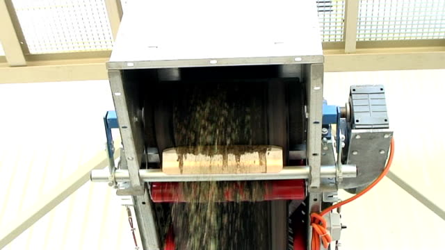 Glass recycling - cullet dropping from conveyor belt video