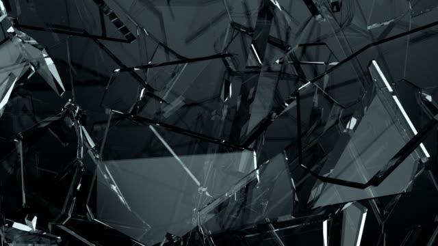 vídeos de stock e filmes b-roll de glass shattered and cracked in slow motion. alpha matte - rachado