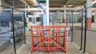 istock Glass Sheets Are Put to Robot Arm 1195196269