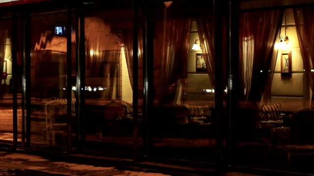 Glass wall of a restaurant in the evening video