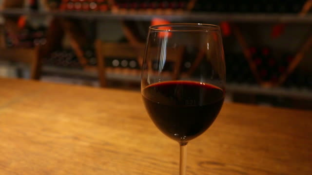 Glass wine on a table, circular tracking shot video