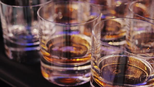 glass with a cold drink - whisky video stock e b–roll