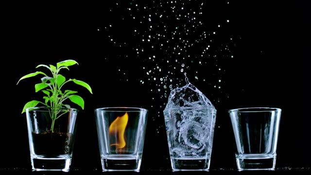 dört elementi temsil eden slo mo ld gözlükler - dört element stok videoları ve detay görüntü çekimi