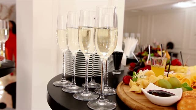 glasses with champagne and fruits on buffet table, buffet table at a restaurant or in the hotel lobby, the camera along, shallow depth of field, welcoming guests in the lobby of the restaurant video