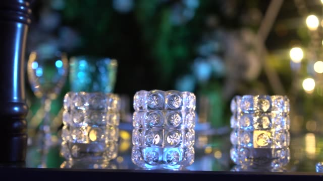 glassware with unusual glasses against blurred bright lights video