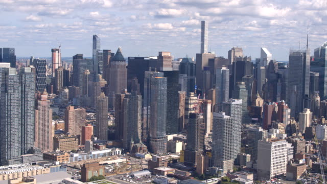 AERIAL: Glassy skyscrapers and condominium apartment buildings in busy New York video