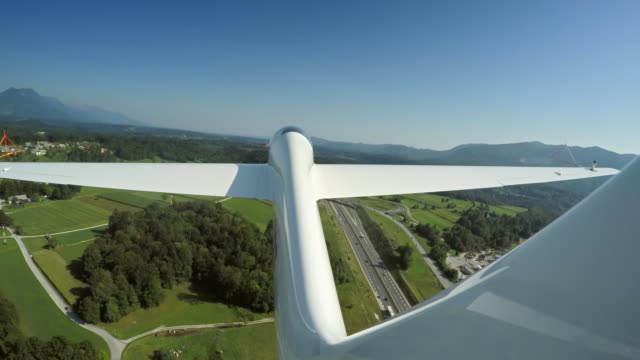 LD Glider being towed in the air above the green landscape
