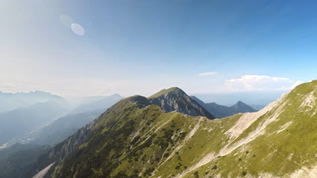 POV Gliding along a sunny mountain ridge