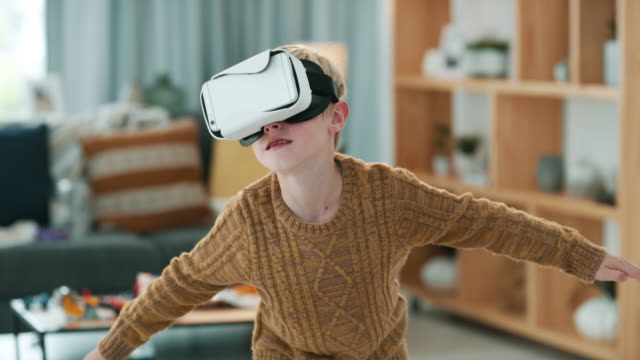 Gliding through a new dimension 4k video footage of a little boy wearing a VR headset at home hands free device stock videos & royalty-free footage