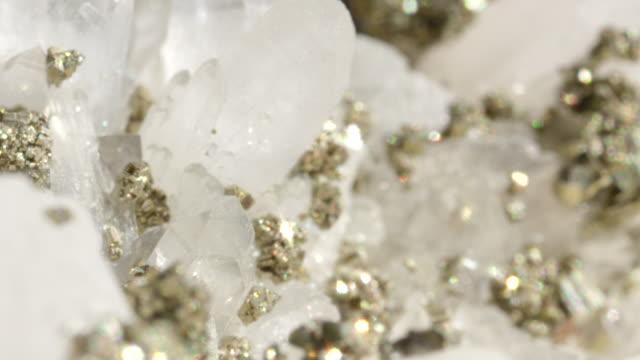 MACRO DOF Glimmering opaque quartz with metallic pyrite creating a pretty sight. video