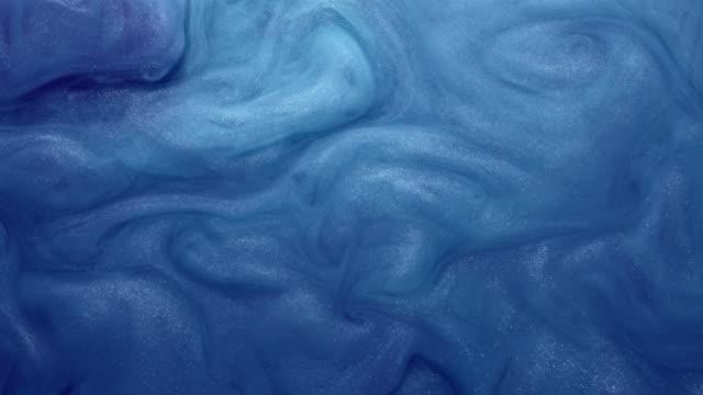 glitter fluid motion skimrande blå färg virvel - akrylmålning bildbanksvideor och videomaterial från bakom kulisserna