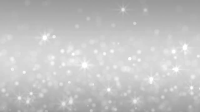 glitter stars and particles silver background - argentato video stock e b–roll
