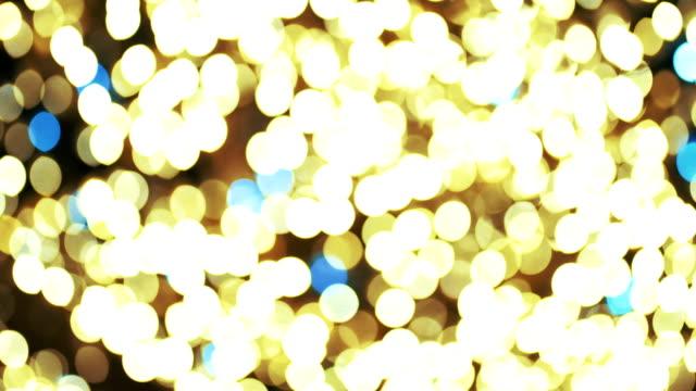vidéos et rushes de glittering floue fond. - image teintée