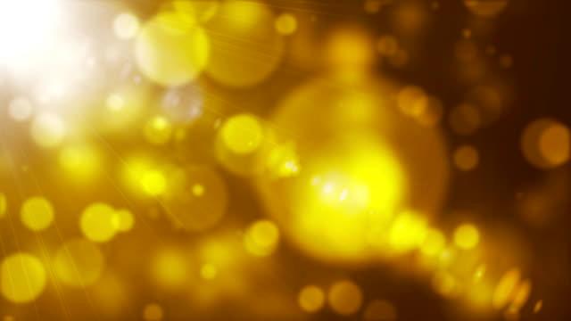 glittering bokeh lights with light rays - luce vivida video stock e b–roll