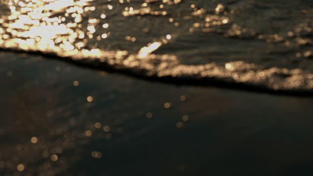 Glittering of sea wave water