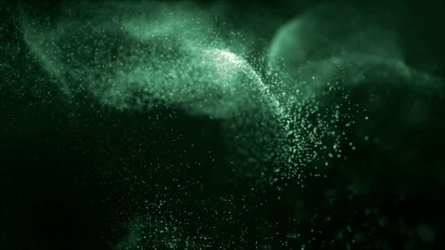 vídeos de stock, filmes e b-roll de partículas brilhantes que espalham no espaço. animação abstrata do fundo 4k com profundidade de campo. - organic shapes