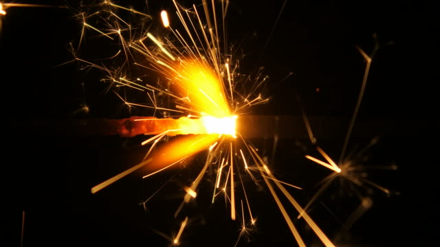 Glittering sparks from burning fire sparkle 1080p : glittering sparks from burning fire sparkle firework explosive material stock videos & royalty-free footage