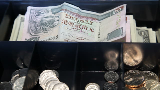 HD: Global Commerce: US Dollars Replace Hong Kong Currency video