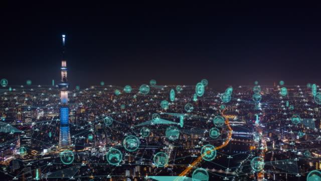 vídeos y material grabado en eventos de stock de tecnología de comunicación global y ciudad nocturna de tokio - prosperidad