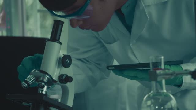 Global Laboratory Alternative medicine serum sample stock videos & royalty-free footage