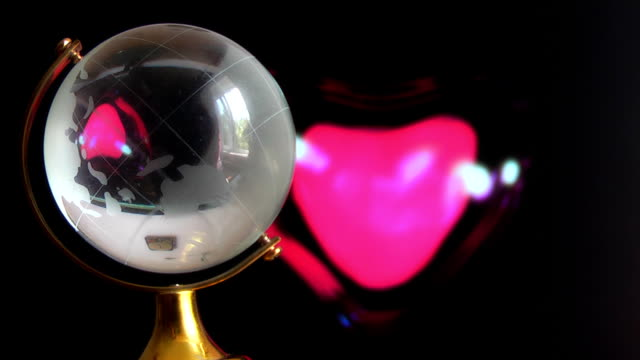 Globe on red beating heart