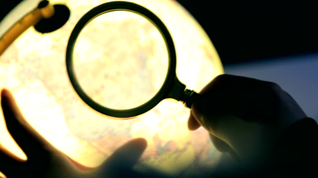 Globe with magnifying glass Globe with magnifying glass magnifying glass stock videos & royalty-free footage