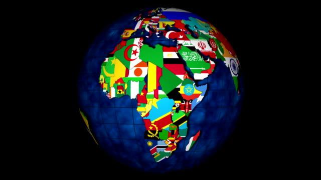 vídeos de stock, filmes e b-roll de globo com oceanos e com os países e as suas bandeiras nacionais girando - país área geográfica