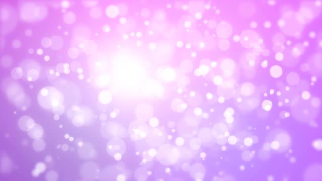 Glowing animated purple pink bokeh background video