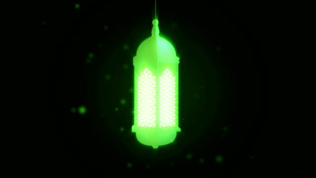 glowing celebration lantern hanging from ceiling on dark background. ramadan kareem islamic motion background. 3d loopable animation. - фанус стоковые видео и кадры b-roll