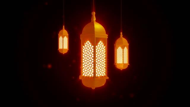 glödande fest lykta hängande från taket på mörk bakgrund. ramadan kareem islamisk rörelse bakgrund. 3d-loopbar animering. - ramadan kareem bildbanksvideor och videomaterial från bakom kulisserna