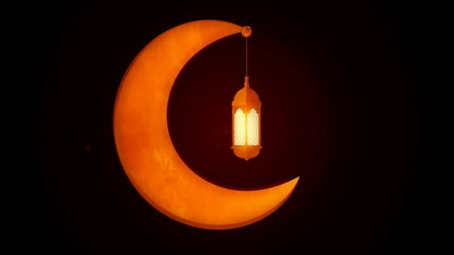 glödande fest lykta hängande i månen på mörk bakgrund. ramadan kareem islamisk rörelse bakgrund. 3d-loopbar animering. - ramadan kareem bildbanksvideor och videomaterial från bakom kulisserna