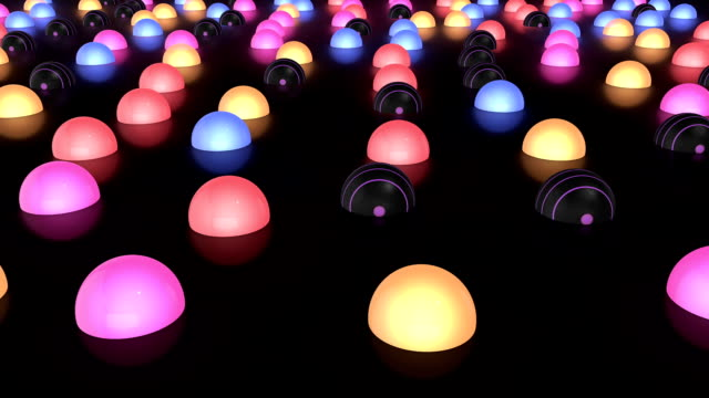 Glowing Colorful Balls Moving Slowly On The Reflective Floor video