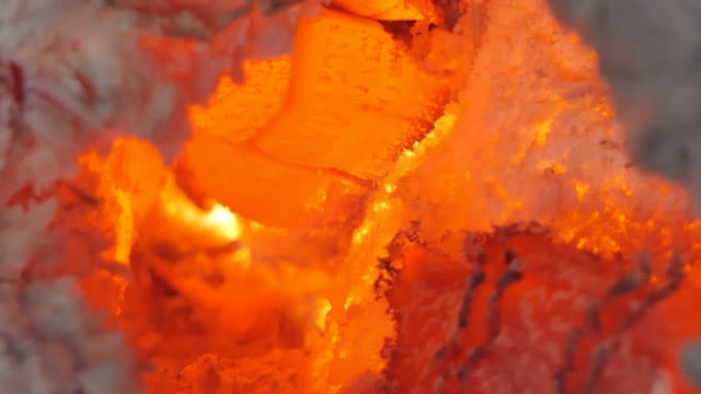 vídeos de stock e filmes b-roll de glowing flame from charcoal and firewood in kiln. - burned oven