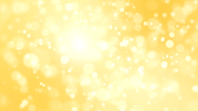 Glowing golden bokeh background Festive golden bokeh background with floating glowing lights. yellow stock videos & royalty-free footage