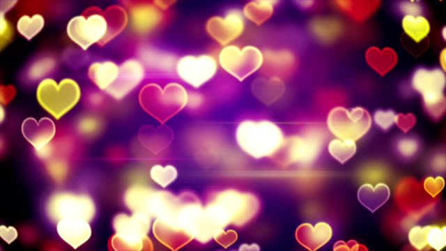 glowing heart shapes bokeh lights loopable background video
