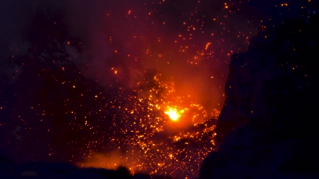 CLOSE UP: Glowing hot magma bursting out of the volcanic crater in Vanuatu. video