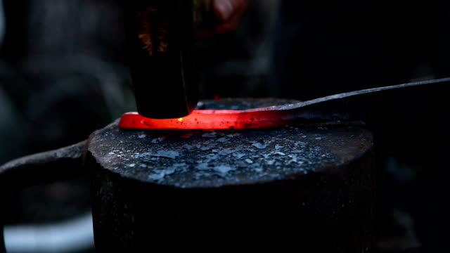 glowing iron glowing iron ready for blacksmith with hammer anvil stock videos & royalty-free footage