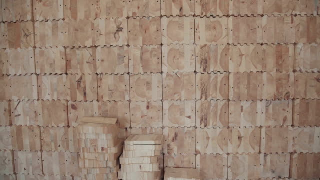 Glued laminated timber in the form of squares with carvings for joints video