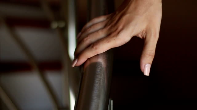 go down the stairs with hand on the railing - parapetto barriera video stock e b–roll