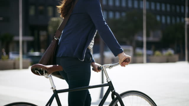 Go the extra mile, it's less crowded 4k footage of a businesswoman out commuting with her bicycle cycle vehicle stock videos & royalty-free footage