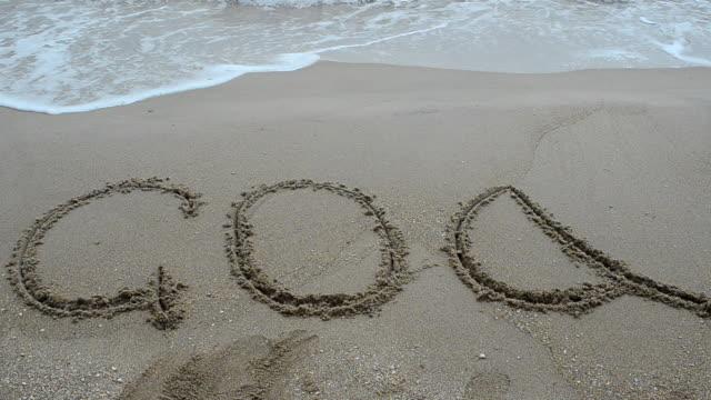 Goa title on the sand beach near the ocean video