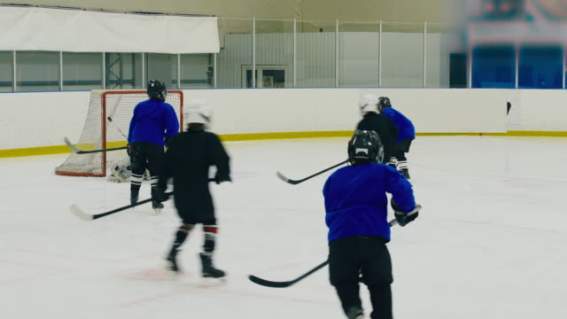 Goal at youth hockey match Children playing professional hockey, attacking post and making goal goal post stock videos & royalty-free footage