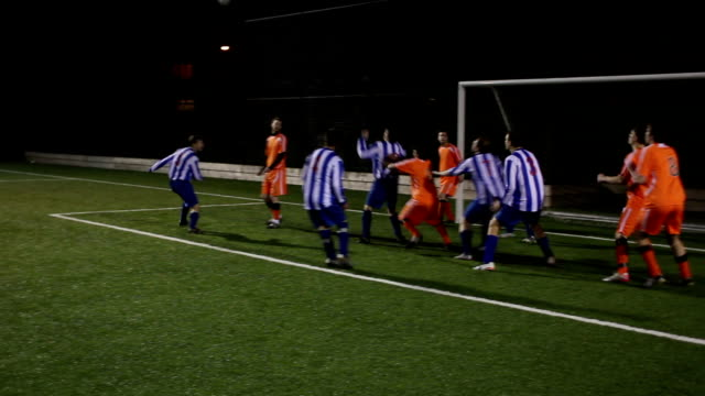 Goal scored from a corner in soccer / football match Stock HD video clip footage of a goal being scored from a corner during a football match scoring a goal stock videos & royalty-free footage