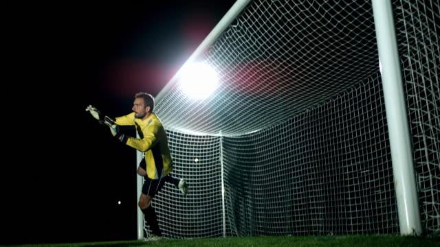 vídeos de stock e filmes b-roll de goalkeeper jump parade, ball in the net - marcar golo
