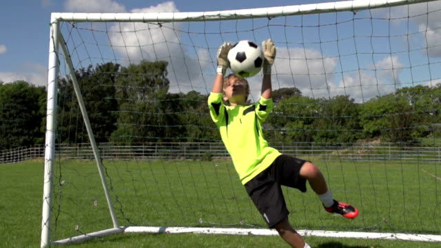Goalkeeper making save, Boy's Soccer / Football Super Slow Motion video