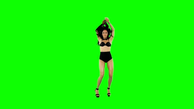 Go-go dancer girl isolated on green screen. Slow motion Go-go dancer girl isolated on green screen. Slow motion. seductive women stock videos & royalty-free footage
