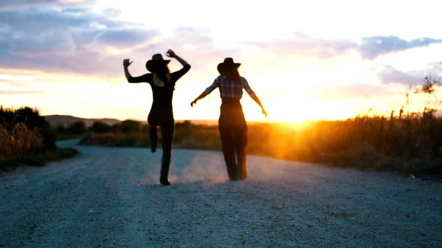 Going on an adventure 27 years old cowgirls are going to take a walk near the ranch. They want to enjoy the sunset cowgirl stock videos & royalty-free footage