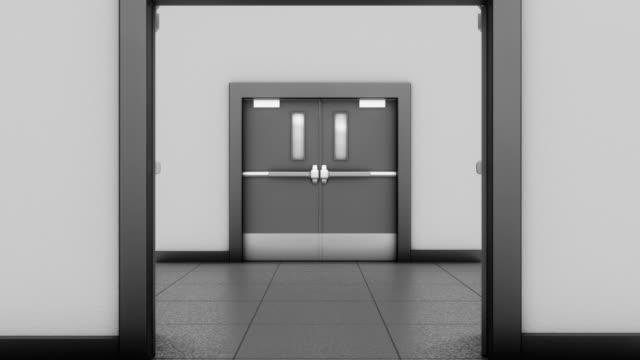 Going through grey industrial double doors.