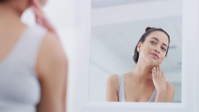 going through her morning routine - woman mirror video stock e b–roll