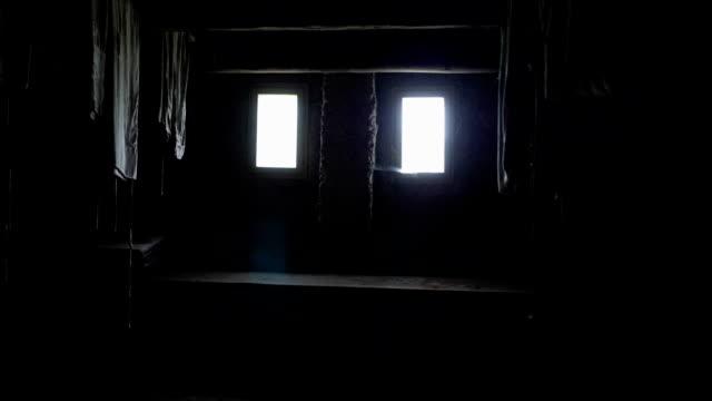stockvideo's en b-roll-footage met doorlopen de zolder aan het licht in het venster. - verlaten slechte staat